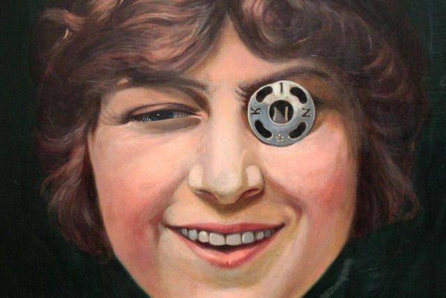 František Kupka: Dívka s patentkou. Portrét mladé Elizabeth Coyensové s patentkou na oku je dobře známý jako logo firmy Koh-i-noor