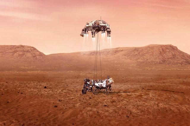 Ilustrace zachycující vozítko Perseverance přistávající na Marsu